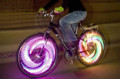 This company makes waterproof lights for the spokes of your bike wheels.  It seems to be marketed to adults, but can you imagine how happy a kid would be to have these on their bike?
